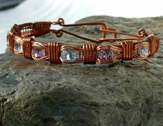 Check out this item in my Etsy shop https://www.etsy.com/listing/565243239/wire-wrapped-copper-amethyst-and-topaz