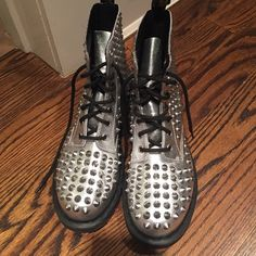 silver dr martins with spikes silver dr martins with silver spikes. worn once. in great condition. VERY rare to find Dr. Martens Shoes