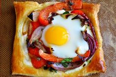 Red Pepper and Baked Egg Galettes from Jerusalem (the book) ~ these eggs baked in puff pastry are the ultimate breakfast in bed recipe! I'm pretty picky about adding to my cookbook collection. Books are wonderful, but take it from someone who has moved a few times in the past couple of years, they can really weigh you down. A cookbook has to be really inspirational to earn a place on my shelf. Jerusalem is the combined effort of Yottam Ottolenghi and Sami Tamimi, a Jew and a Muslim…