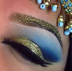 Cleopatra makeup with gold glitter brow