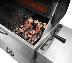 The PRO605CSS Charcoal Professional is the grill and smoker of your dreams. Shown is the adjustable charcoal bed, perfect for those big roasts, smoked meats and veggies!