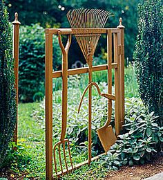 Garden gate made of tools bolted together & spray-painted
