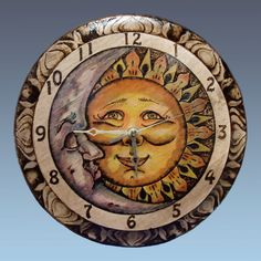 Sun and Moon Pyrography Clock by tinattlg on Etsy, $85.00