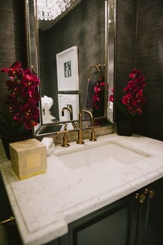 Powder Room. Beautiful powder room with dark gray grasscloth wallpaper framing beveled beaded mirror over black vanity topped with white marble beveled countertop. #PowderRoom