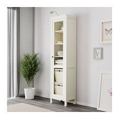 IKEA - HEMNES, Glass-door cabinet, white stain, , Solid wood has a natural feel.With a glass-door cabinet, you can show off as well as protect your glassware or your favorite collection.You can choose to install the door to the right or left, according to what fits the space best.The shelves are adjustable so you can customize your storage as needed.1 stationary shelf for high stability.You can hide multiple power strips, etc under the removable bottom shelf.Adjustable feet for stability on…