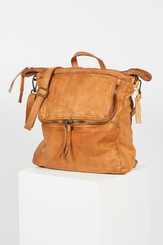 Loved Leather Messenger   So soft distressed leather backpack featuring adjustable/removable shoulder strap for versatile wear. Front zip pocket and zip top closure. Soft lining and multiple inner pockets.
