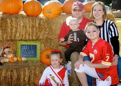 Family football theme costumes. Coach, ref, football player, cheerleader, and a little football.