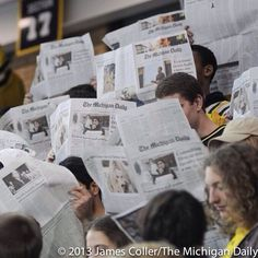 umich students at last semester's hockey game at Yost Ice Arena were captivated by a recent edition of the Daily. We're quite partial to it as well.