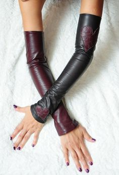 Hearts Leather sleeves or fingerless gloves also known as Kittys.