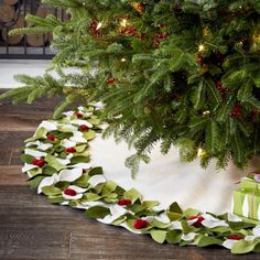 Shop Mistletoe White Felt Tree Skirt.  This festive felt tree skirt rings a profusion of dimensional mistletoe leaves and berries appliqués on white felt to create a beautiful base for your holiday tree.
