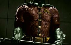 Robin's suit with color and without graffiti. Awesome!! They said in the movie the pole that the suit is holding is what the joker tortured him (Jason Todd) with... In the comics it was actually a crowbar