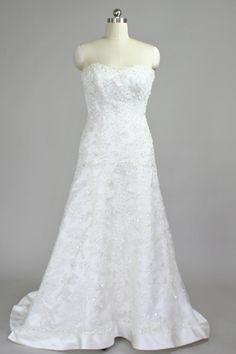 Slim, sophisticated A-line gown by James Clifford with re-embroidered, beaded lace over satin.