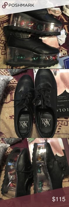 YRU QLOUD 2091 BLACK Fillable flatform shoes. Customize these adorable shoes to match your mood! These retail for $150 from Dollskill. These have been worn 4 times, and can come with and without the current filling (confetti). Feel free to make reasonable offers, but keep in mind I need to make some money back, and posh takes 20%. Happy poshing! YRU Shoes Platforms