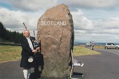 """Border crossing at Carter Bar - the other side of the stone says """"England"""" - and there's usually someone there to 'pipe you out'."""