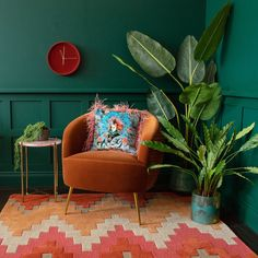 Add life to your interiors with a selection of faux house plants like our Faux Travellers Palm Tree Velvet Armchair, Velvet Cushions, Oranges Sofa, Tropical Rugs, Tropical Decor, Travellers Palm, Living Room Orange, Orange Interior, Pink Feathers