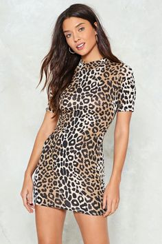 634b958eb2 Stay true to you. The Never Change Your Spots Dress features a leopard print  throughout