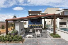 Designed specifically for entertaining, this smart outdoor setup makes good use of half-walls as perfect perches for bar seating, while simultaneously compartmentalizing this expansive outdoor area into functional zones.