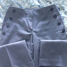 Sailor Style Pants The color is a true gray with a slight sheen. It has 3% spandex. I have only worn them twice. LOFT Pants Boot Cut & Flare