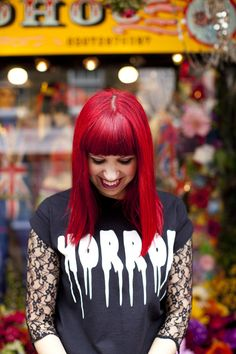 Love the lace top under her horror tshirt and that hair wow, I love cherry red! x