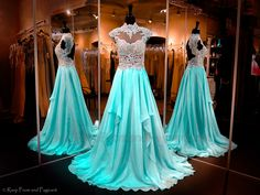This beautiful aqua chiffon evening gown features a high lace neckline with gorgeous applique - 116JV0206610 AQUA at Rsvp Prom and Pageant, Atlanta, GA