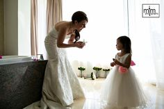 Mother & daughter getting ready. Moon Palace Golf & Spa Resort. All inclusive beach wedding hotel located in the Riviera Maya. Best Destination Cancun Wedding Photographer. Unique wedding ideas from MTM Photography based out of Playa del Carmen.