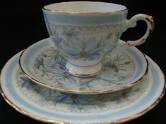 Tea trio by Tuscan China with pattern of blue daisy like flowers with hand painted