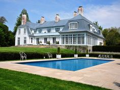This wonderful estate is set on eleven acres of well landscaped grounds. The estate looks as if it is set in the European Country side. What fascinates me about this home is the large windows.