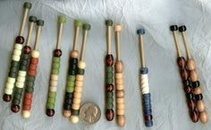 "Bobbin Lace - These bobbins are from bamboo skewers, ""ceramic look"" matt finish pony beads, wooden beads, and the blue one has a ceramic white bead.  I used hot glue gun, but if you do, be sure these stay in the shade and are not left in a hot car. A better glue might be worth considering.  I found that the ones with more weight work best, so add at least one ceramic bead or heavier glass bead per bobbin like the blue and white bobbin."