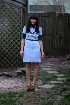 I love the idea of layering tops underneath dresses to make them more appropriate for cooler weather and, in addition to the lovely colors represented in this look, I also love that unique chain-link necklace.