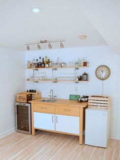 Turn an unused area of your basement into a kitchenette-slash-bar for an alternative spot to entertain guests. Blogger Alex ofNorthstory created a welcoming, vintage vibe with an antique wall clock, wooden crates, and pipe shelving. See more of this project atHomeTalk.   - HouseBeautiful.com