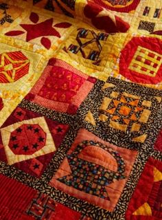 Reds, golds, browns, oranges in quilt.