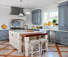 We love the gorgeous blue cabinets in this French kitchen! More country French decorating ideas: http://www.bhg.com/decorating/decorating-style/country-french/country-french-decorating-ideas/?socsrc=bhgpin071313frenchkitchen=4