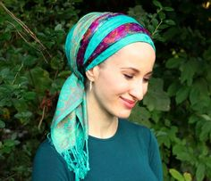 This is one of Andrea's new favourite scarves! The subtle print on the tichel reminded us of the poem Footprints - it looks like gentle footprints in the sand or snow. This headscarf honors the bright nurturing woman with its lively colors and gentle patterns. The evocative design at the base of the scarf give it weight, elegance, and dignity. Wear this tichel in place of your usual pashmina and enjoy the soft beauty! <em>Andrea and Rivka Malka's mom are wearing their Footprints tichels with…