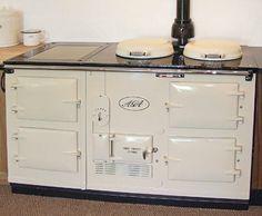 The Polished Pebble: The Kitchen Considered: The Trophy Stove.one day AGA.you will be mine! Kitchen Mantle, Aga Kitchen, Cosy Kitchen, Pine Kitchen, Kitchen Ideas, Kitchen Stuff, Best Cooker, Aga Cooker, Oven Cooker