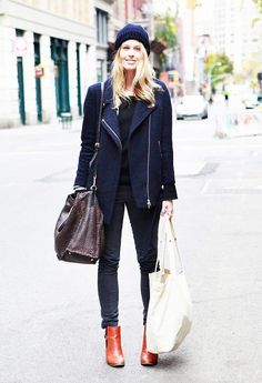 Navy beanie, moto-styled jacket, black simple tee, black skinny jeans, and tan leather boots