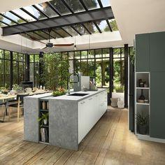 Kitchen with glass panelling opening onto dining space and view of garden. Custom Kitchens, Bespoke Kitchens, Cool Kitchens, Concrete Kitchen, Glass Kitchen, Appartement Lausanne, Interior Exterior, Kitchen Interior, Made To Measure Wardrobes