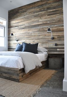 Wood wall + bed - built in bedside tables, concrete - jute rug