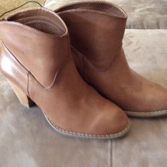 Forever 21 ankle boots.  NWT Brown Forever 21 ankle boots.   Never worn, excellent condition. Forever 21 Shoes Ankle Boots & Booties