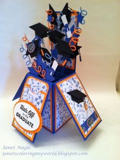 Stamps: My Favorite Things - LLD Happy Graduation Cardstock: Stampin' Up Brilliant Blue, Only Orange, Blue & white floral decorative paper, Gator paper and Cougar Opaque white Dies : My Favorite Things LLD Graduation Accents & Looped Border Dies Spellbinders classic Oval & Scalloped Oval Dies Miscellaneous: Star Punch