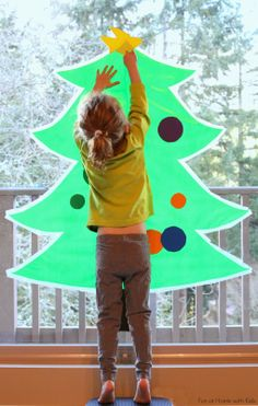 Sticky Kid-Sized Christmas Tree with reusable ornaments - you can decorate all season long!  From Fun at Home with Kids