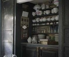 Dark country kitchen with black pantry and open shelving