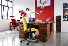 Workspace Design With Red And Yellow Office Swivel Chair Also Classic Wood Office Desk Under White Reading Lamp