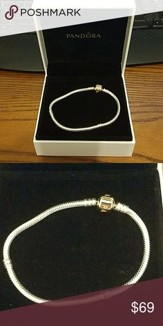 NIB Silver Pandora Bracelet w/Rose Clasp Brand new in box. Authentic Pandora Sterling Silver with rose gold clasp bracelet. $ firm unless bundled. Smoke and pet free home. Thanks for visiting my closet. Pandora Jewelry Bracelets