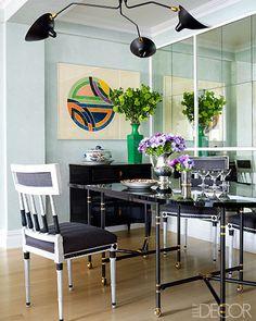Dining Room. 1960s Maison Jansen table, Gustavian-style chairs, Serge Mouille fixture, Frank Stella print. ED November 2013. Designer: Caroline Cummings Rafferty.