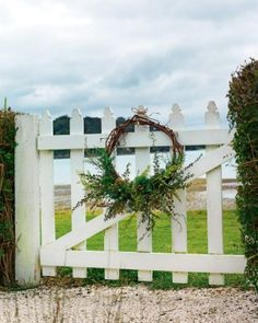A wreath of grapevines and manuka on the beach gate, made by family friend and island florist Vicki Roycroft, of Wildflower, who also did all the other wreaths and flowers for this story.