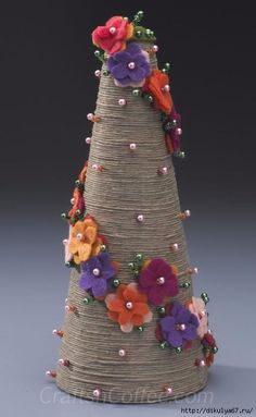 Patty Schaffer has done it again – she's sharing another must-have springtime topiary to DIY. Her Divine Twine Topiary pairs rustic twine with bold felt flowers and sparkling beads for a stunning c.DIY jute twine topiary tutorial by Patty Schaffe Cone Christmas Trees, Christmas Tree Crafts, Felt Christmas, Christmas Projects, Handmade Christmas, Holiday Crafts, Christmas Decorations, Christmas Ornaments, Xmas Tree