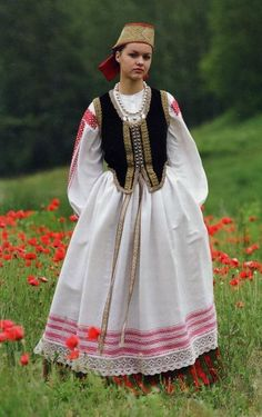 A Lithuanian woman wearing a folk costume.