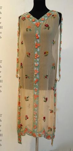 1920s sheer silk chemise flapper dress with embroidered floral sprigs and gorgeous heavily beaded ribbon embellishment. The ribbon beadwork features salmon colored mini rose ribbon bouquets against rows of turquoise seed beads. Back view detail.