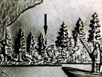 "Does Your Minnesota State Quarter Have an Extra Tree?: The Minnesota State Quarter ""Extra Tree"" doubled die error.  This type is identified by CONECA as DDR-1.  The arrow points to the location of the extra tree."