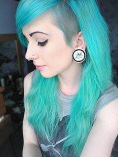 Aqua hair with a shaved side . I can't wait for my hair on top to grow out long like this!